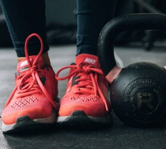 Women's athletic sneakers and kettlebell