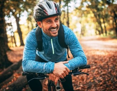 man riding bike in fall