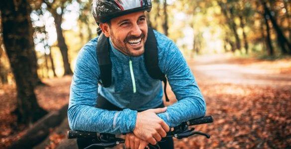 man riding bike in fall