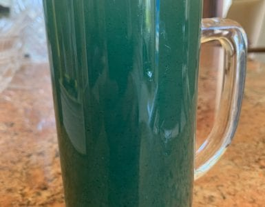 spirulina summer iced tea drink in a glass