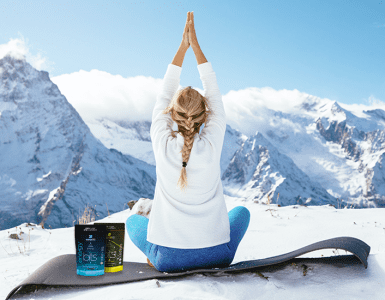 woman doing yoga in mountains