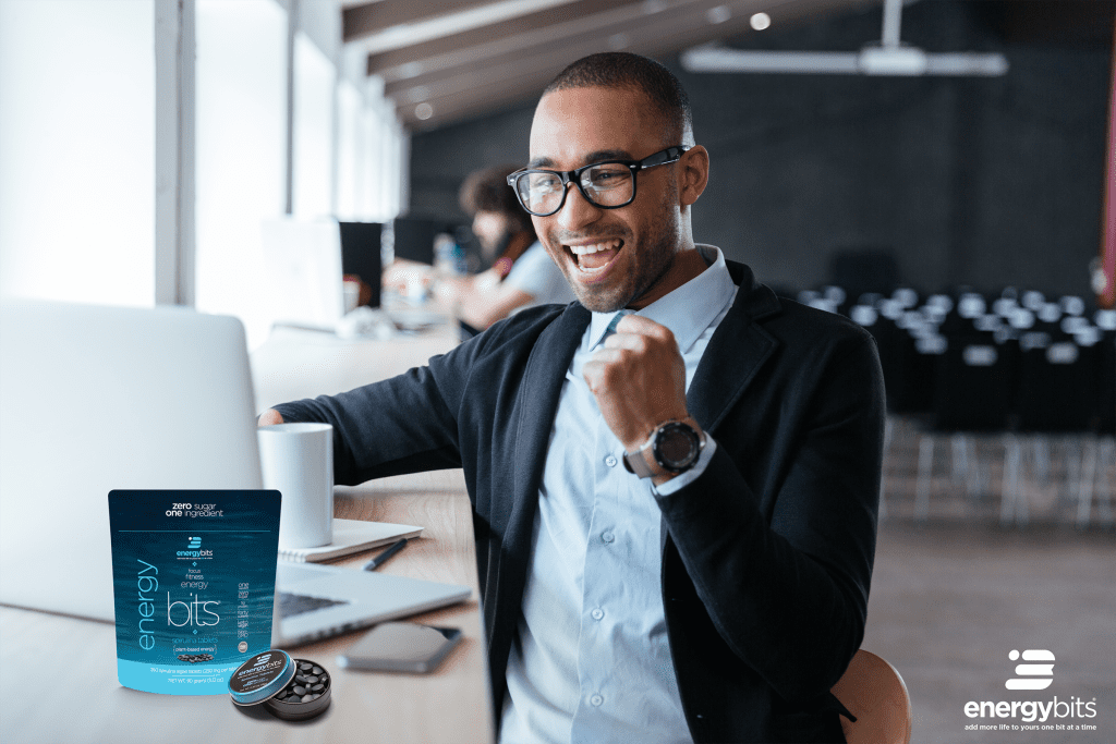 man at desk with bag of ENERGYbits