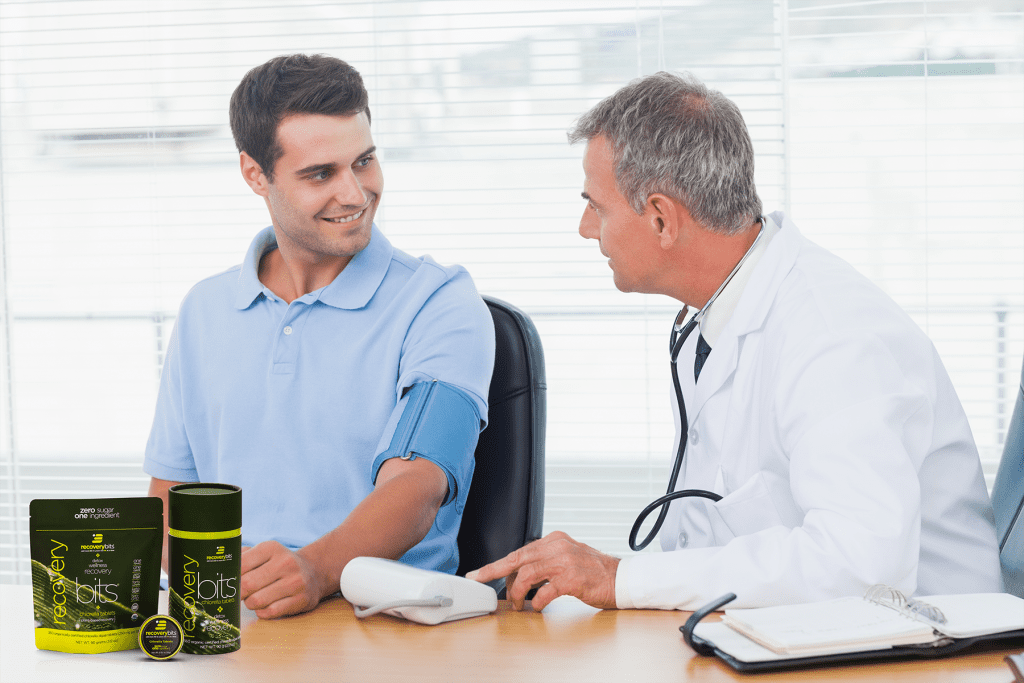 Two men taking blood pressure