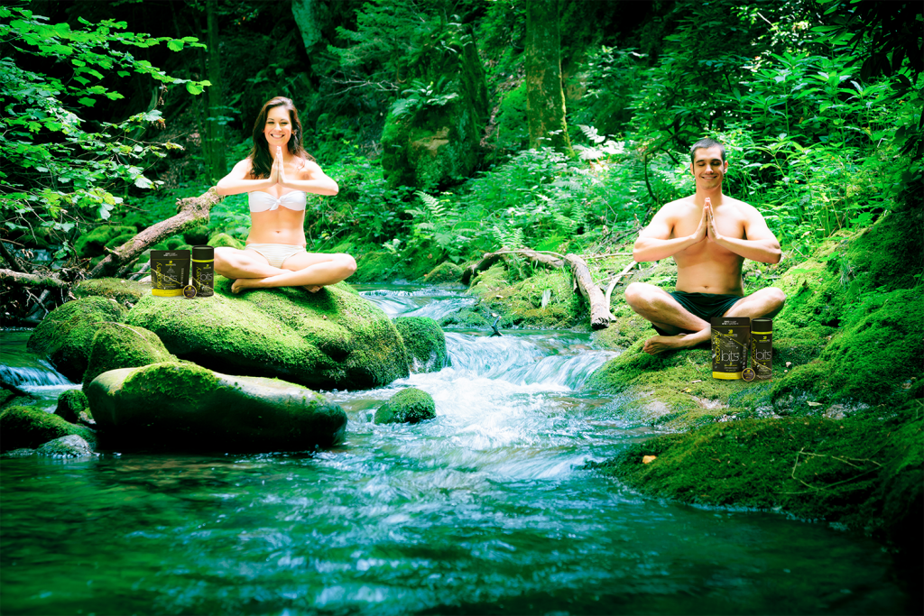 man and woman meditating in jungle
