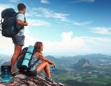 man and woman on top of mountain