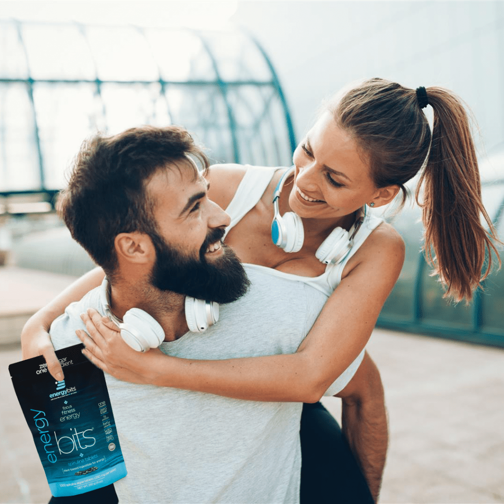man and woman holding algae