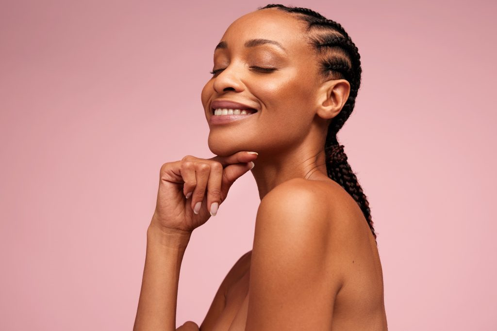 woman glowing and happy, pink background