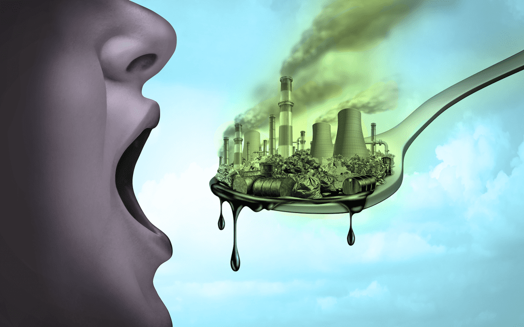image of someone eating a city of toxins and pollution