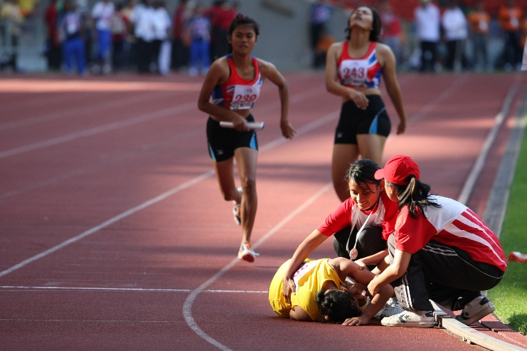 injured runner on ground